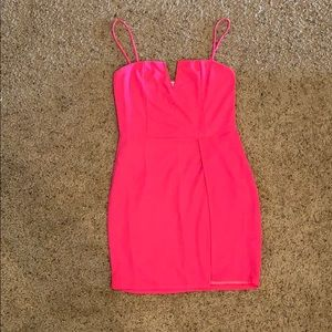 Bright pink fashionNova mini dress with slit